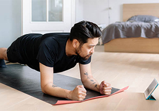 man-uses-digital-tablet-to-learn-plank-position-in-his-home_thumbnail