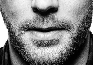 investments-etf-card-en-fr-closeup-mouth-chin-of-bearded-man