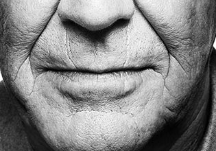 investments-etf-card-en-fr-closeup-mouth-chin-of-old-man