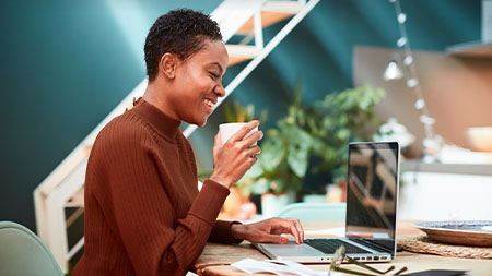Woman smiling and working at her computer